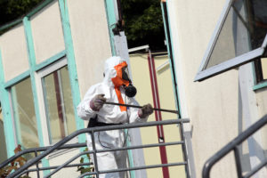 What should be done about asbestos in the house?